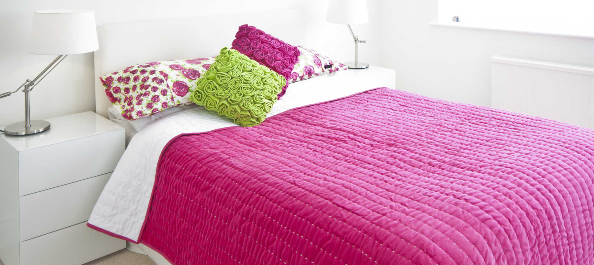 Opal Pink bedspread and rufus velvet cushions ragged rose