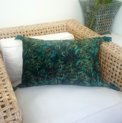 blue peacock feather print velvet cushion